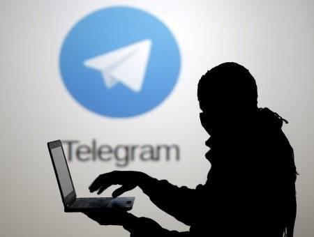 1539341348_silhouette-man-lap-top-front-telegram-logo.jpg